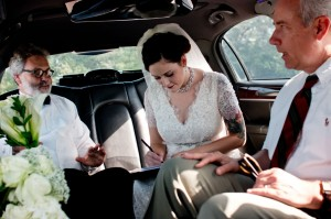 Signing the marriage license in the limo before we say the vows.